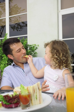 Girl feeding man crisp Stock Photo - 8980986