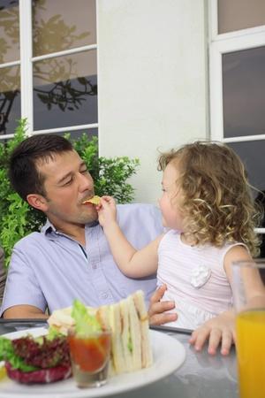Girl feeding man crisp photo