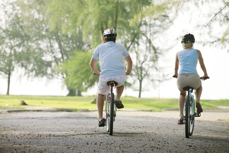 Man and woman cycling in the park Stock Photo - 8981558