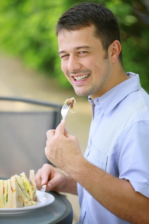 Man having a meal at an outdoor restaurant photo