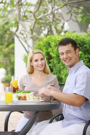 Man and woman having a meal at an outdoor restaurant Stock Photo - 8981130