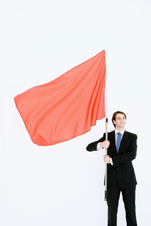 Businessman standing with red flag in his hands Stock Photo - 9041409
