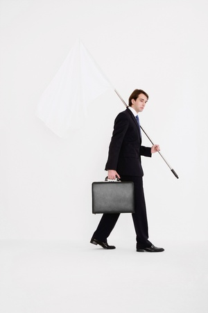 Businessman holding a while flag Stock Photo - 9041485