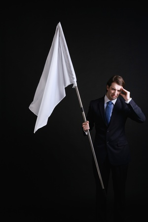 Businessman holding a while flag photo