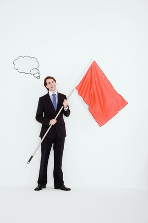 Businessman holding a red flag with thought bubble above his head Stock Photo - 9042685