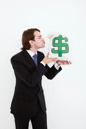 Businessman kissing money bag Stock Photo - 9043481