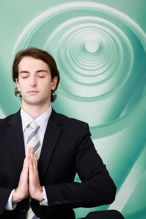 Businessman meditating photo