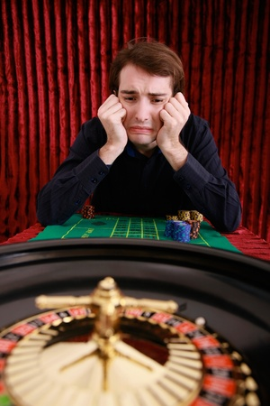 lose up: Man losing in roulette at casino