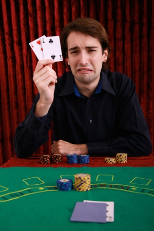 Man holding up playing cards photo