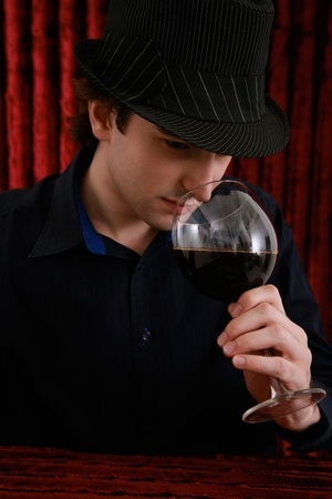 Man smelling red wine in glass photo