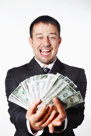 man holding money: Businessman counting money happily