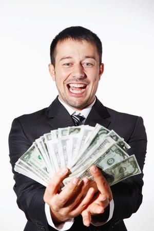 contando dinero: Empresario contando dinero felizmente Foto de archivo