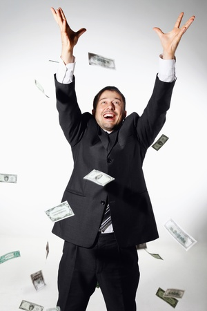 greedy: Businessman throwing money in the air