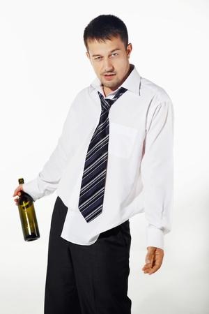 Drunk businessman holding an empty bottle