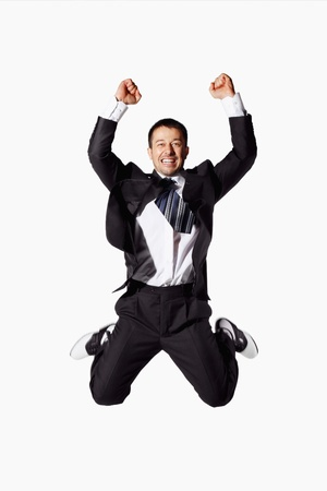 jump suit: Businessman jumping up in joy Stock Photo