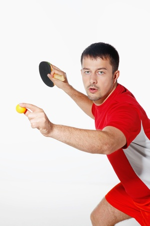 Man playing with table tennis ball and bat photo