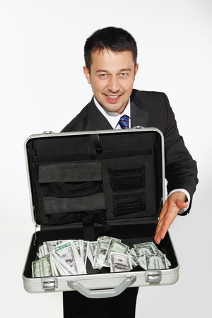Businessman showing a briefcase of money Stock Photo - 9043252