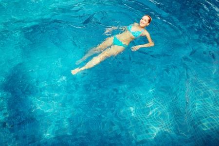 Woman swimming in pool photo