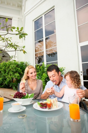 Family having a meal at an outdoor restaurant photo