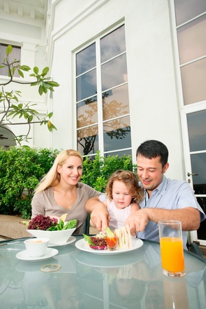 Family having a meal at an outdoor restaurant Stock Photo - 9041744