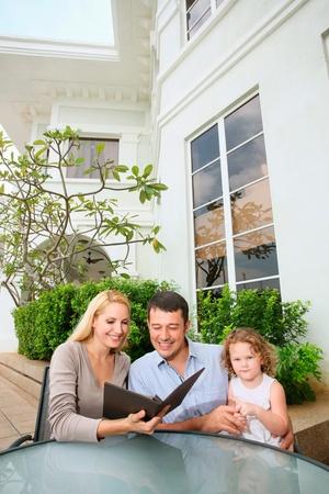 Family looking at menu at an outdoor restaurant photo
