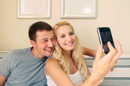Man and woman talking picture using camera phone Stock Photo - 9041634