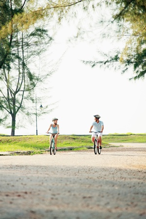Man and woman cycling in the park Stock Photo - 9037977