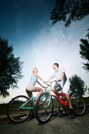 Man and woman cycling in the park photo