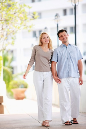 Man and woman holding hands while walking Stock Photo - 9043483
