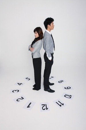 Business people standing in circle of numbered papers photo
