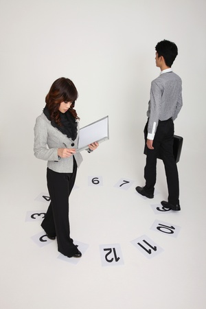 Business people walking on numbered papers at opposite ends Stock Photo - 9288484