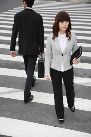 Business people crossing the road photo