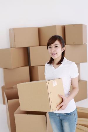 Woman carrying cardboard box photo