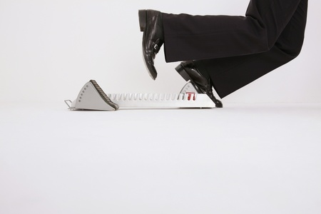 Businessman on starting block photo