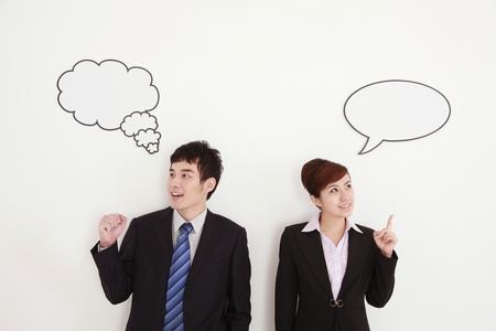 Business people with thought and speech bubble above their heads photo