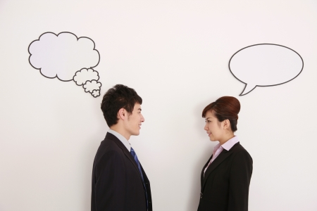 Business people with thought and speech bubble above their heads Stock Photo - 9288779
