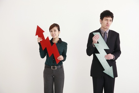 Business people holding arrow signs Stock Photo - 9288774