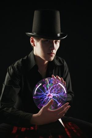 crystal gazing: Man looking into crystal ball