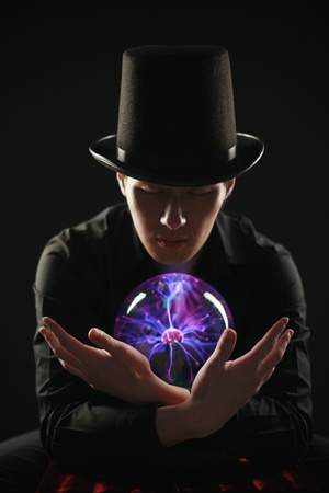 Man looking into crystal ball photo