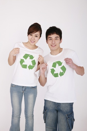 Man and woman wearing t-shirts with recycling symbol photo