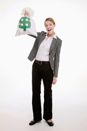 Businesswoman holding a money bag Stock Photo - 9287867