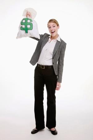 Businesswoman holding a money bag Stock Photo - 9287867