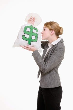 Businesswoman kissing money bag Stock Photo - 9288466