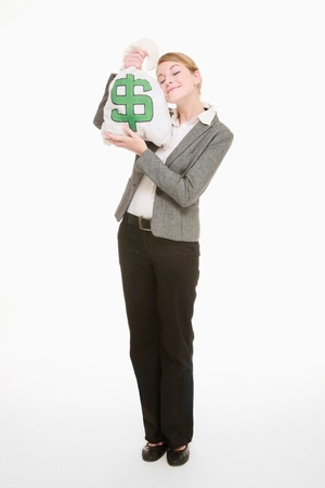 Businesswoman holding money bag close to her face Stock Photo - 9287743