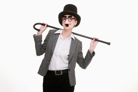 Businesswoman with funny disguise and dance cane photo