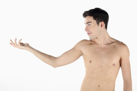 Man with arm outstretched Stock Photo - 9287237