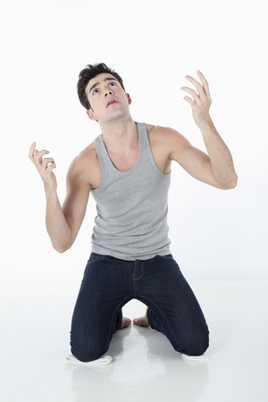 Man kneeling down and looking up Stock Photo - 9288454