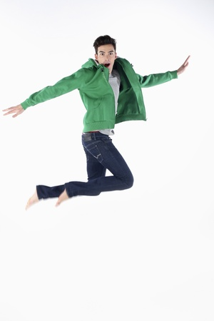 Man in hooded jacket jumping in the air Stock Photo - 9287201