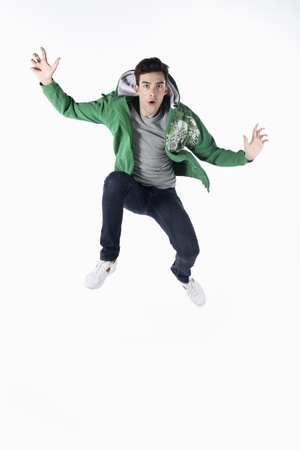 Man in hooded jacket jumping in the air Stock Photo - 9288198