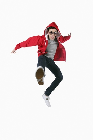 Man with sunglasses jumping in the air photo